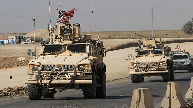 تخفيض اعداد القوات الامريكية في العراق ووضع جدول زمني لانسحابها بالكامل