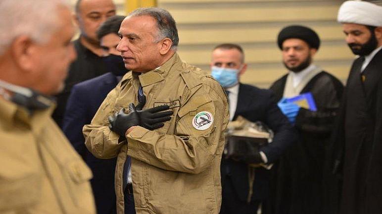 بالصور.. الكاظمي يرتدي زي الحشد الشعبي ، العسكري